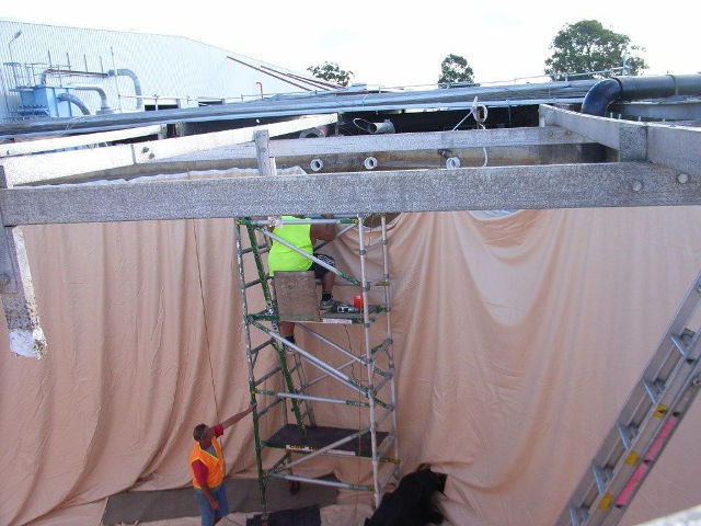 Installing a tank liner at a commercial site