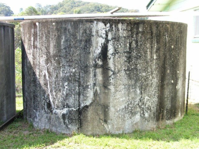 A concrete tank showing its age
