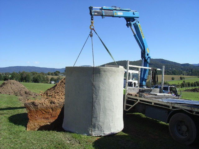 A new concrete tank being positioned